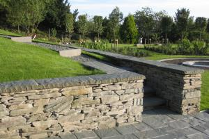 Traditional stone walls & slate paved patio