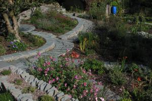 The garden has slate paths that sweep through large planting beds