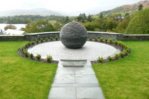 A stone globe sculpture standing a meter high is the amazing centerpiece in the