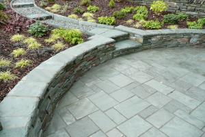 This small patio is stylish with its curved walls creating a perfect place to re