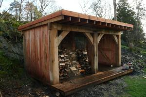 The oak framed timber shed built back in to the quarried side